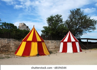 two historical medieval camp tent red, white and yellow