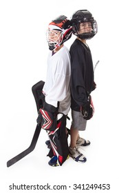 Two hockey players with equipment over a white background
