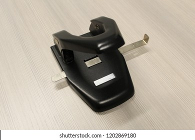 Two hole paper puncher