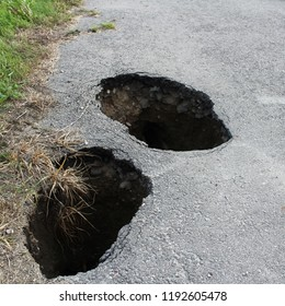 Two holes on the road