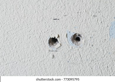 Two holes in the wall foam or aerated concrete for the installation of dowels for bolts