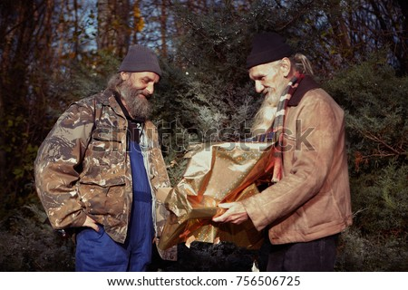 Two Homeless Older Men Celebrating Christmas Stock Photo Edit Now