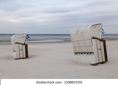 Two hooded beach chairs on a beach at the baltic sea near Scharbeutz, Germany