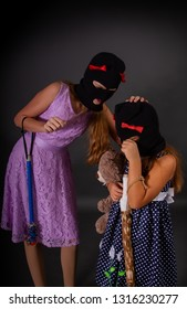 b8b7611838a61 Two hooligans of a teenager girl in bright elegant dresses