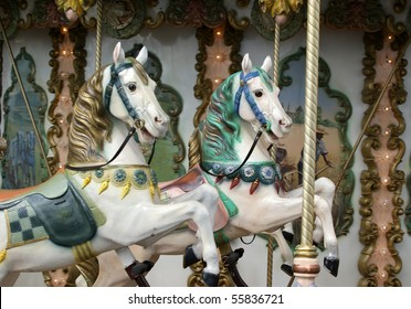 Two horses carousel child closeup