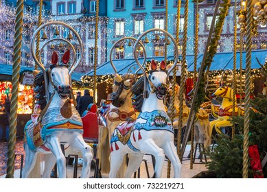 Two horses from the christmas decorated merry-go-round in Mainz square