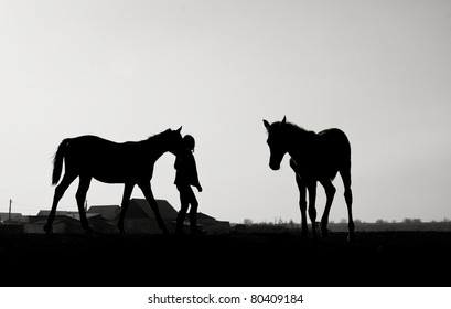 Two Horses and Woman