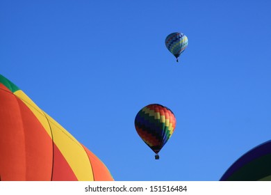 Two hot air balloons in blue sky