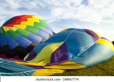 Two hot air balloons on their side