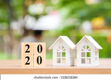 Two house and 2020 wooden blocks number. New year property investment concept.