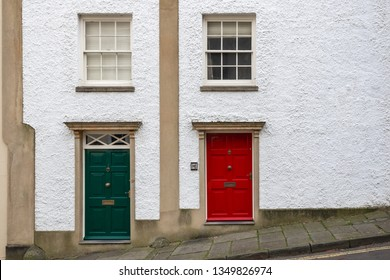 Two house frontages decorated with green and red doors around Brandon Hill in Bristol, England, UK
