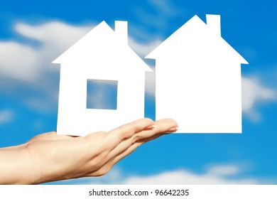 two houses on the hand on blue sky background