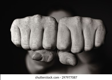 Two human fists. Aggression MANY OTHER PHOTOS FROM THIS SERIES IN MY PORTFOLIO.