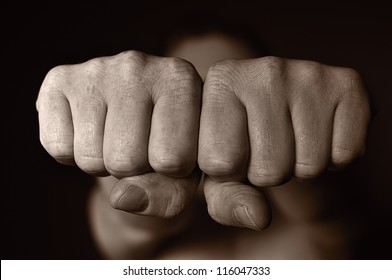 Two human fists as a symbol of aggression. OTHER PHOTOS FROM THIS SERIES IN MY PORTFOLIO.