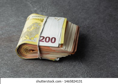 two hundred euro banknote in bundle or rubber band for money isolated on grey background. horizontal photo