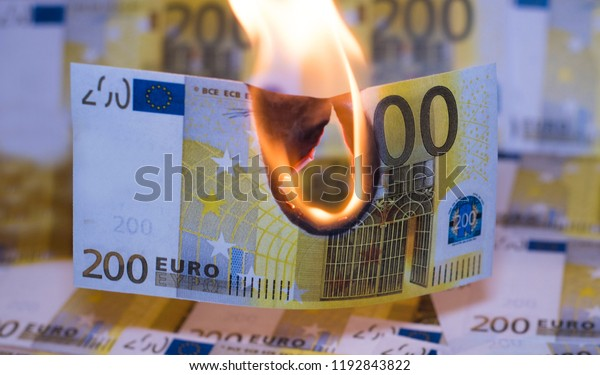 Two hundred euro bill in Europe currency is on fire.
