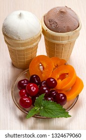 Two ice cream and fresh fruit on the table