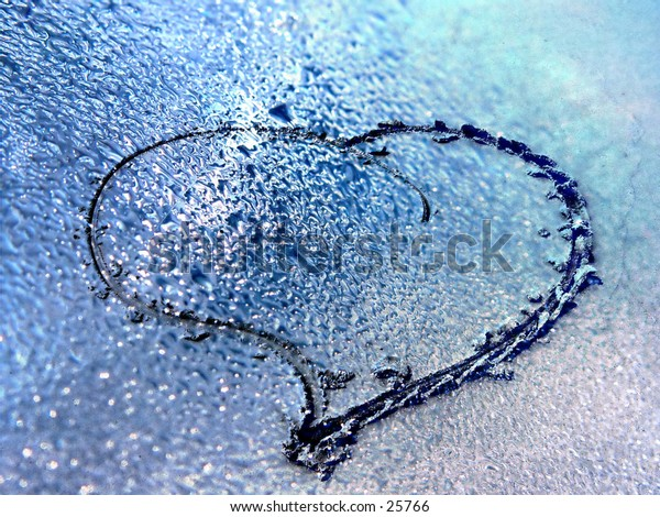 Two images together, heart shape in the sand with rain drops, abstract background