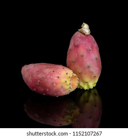 Two Indian aka Barbary figs, Opuntia ficus-indica on black background. Aka Prickly pear, tuna fruit. Square crop.