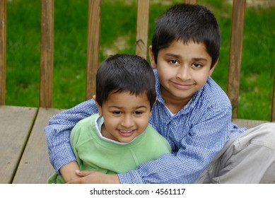 Two Indian brothers happily hugging each other