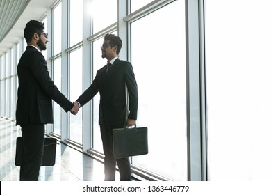 Two Indian business men shaking hands