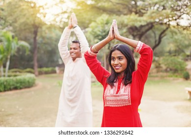 Two indian people doing yoga in the park