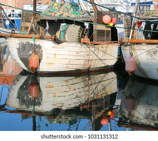 two industrial fishing boats moored near the sea