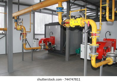 Two industrial gas coppers in a modern boiler-house