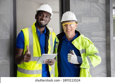 Two Industry Engineers Looking to the Camera with Thumb Up