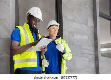 Two Industry Engineers Use Digital Tablet to Discuss about Their Work