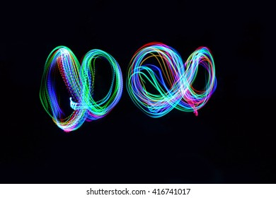 Two infinity signs on black background