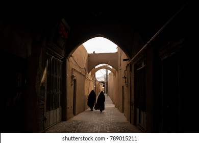 Two Iranian women are walking in a historical area in Yazd. Iran.