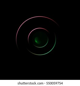 two iridescent concentric rings with green center on black background