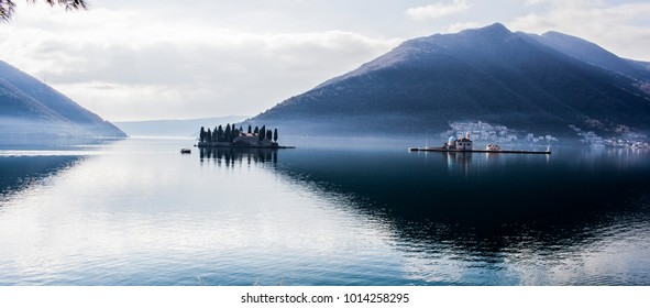 Two islets off the coast of old town Perast in Bay of Kotor, Montenegro. Ostrvo (islet) Sveti Djordje on the left and Our Lady of the Rocks on the right