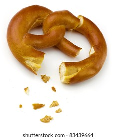 Two isolated pretzel pieces over white background.