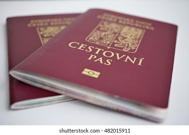 Two isolated red Czech passport with a state symbols (lions and eagles) and captions Czech Republic and European Union in Czech language