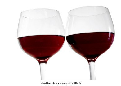Two isolated red wine glasses