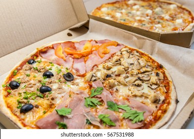 Two Italian pizza for dinner:  quattro fromaggi  pizza and pizza four seasons