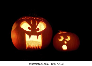 Two Jack-o-lantern's with humorous expressions.