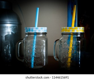 Two jars with colored straws