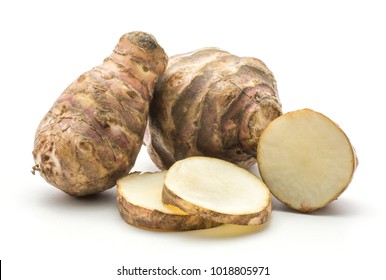 Two Jerusalem artichoke tubers with three round slices isolated on white background sweet crisp topinambur