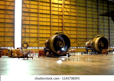 Two jet engine remove from aircraft (airplane) for maintenance at aircraft hangar.Jet engine maintenance and change part by aircraft technician.
