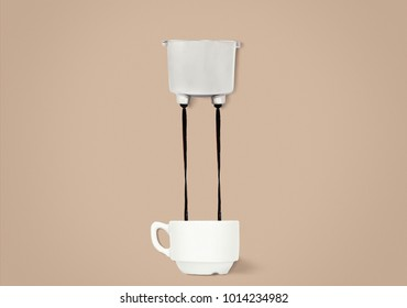 Two jets of coffee are pouring from the group of handles into a cup for coffee. Coffee making process in minimalist style