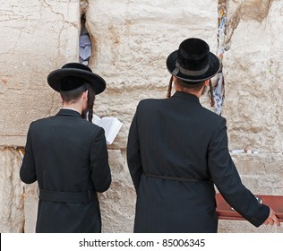 Two jews at the western wall of mourning. Jerusalem. Israel.
