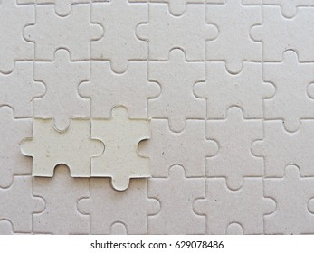 Two jigsaw puzzle connected on puzzle  background.