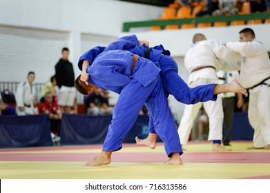 Two judokas in blue judo kimonos fighting