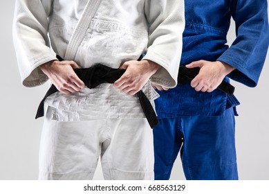 The two judokas fighters posing at studio