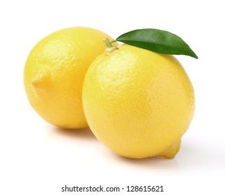 Two juicy lemon with leaf
