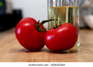 Two juicy red tomatoes close-up
