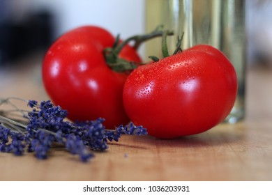 Two juicy red tomatoes and lavender close-up
